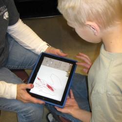 child working on iPad