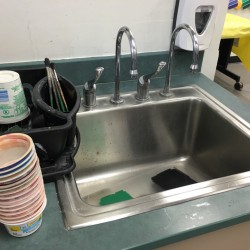 sink with water cups next to it