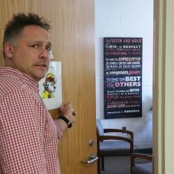 teacher entering principal's office