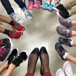 students' feet and teacher's feet in a circle