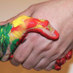 handshake where one hand is painted