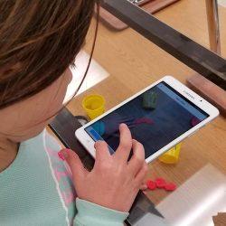 girl using ipad to document artwork