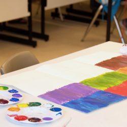 student creating artwork