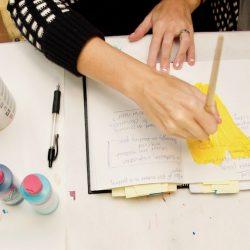 hands working in sketchbook