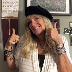 Debi wearing a beret