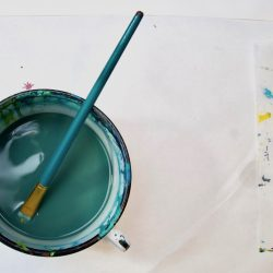 paintbrush in water cup