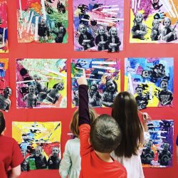 image of students looking at their artwork