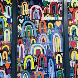 Rainbows painted on windows