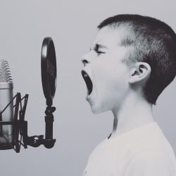 boy yelling into a microphone