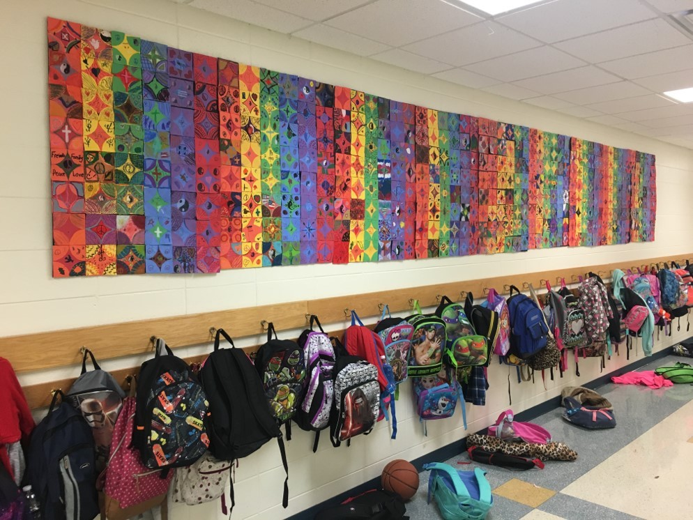 paper quilt display on school wall