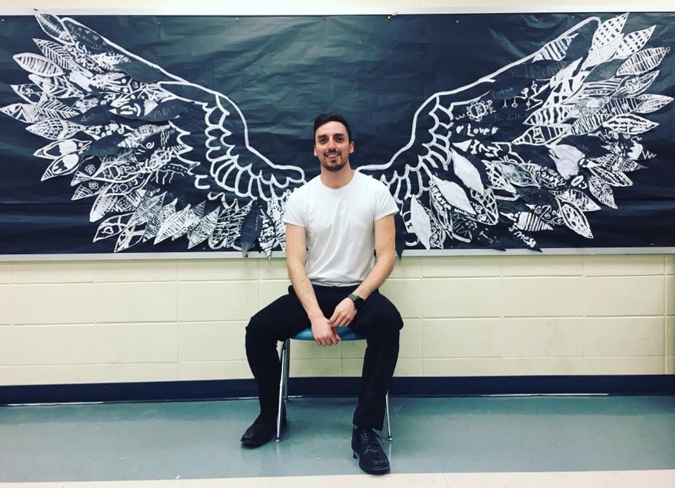 man with wings made with student artwork