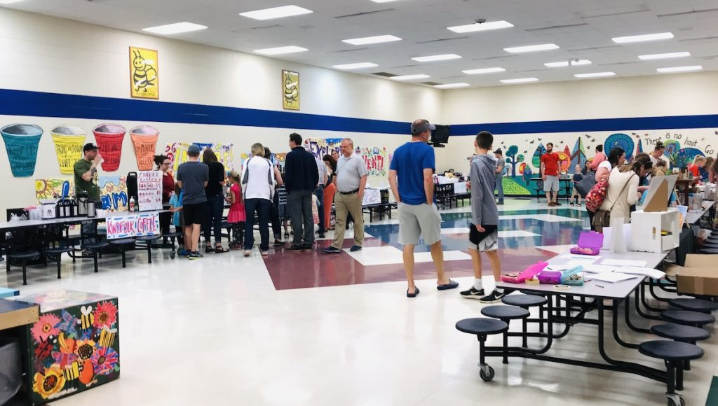 parents and students at a school artshow