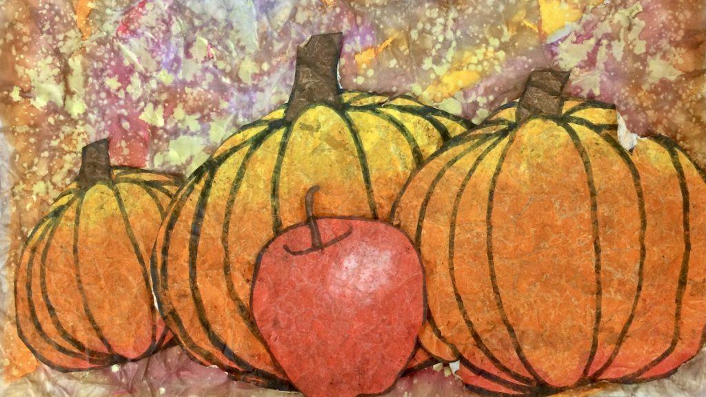 artwork with pumpkins using oil pastel batik technique
