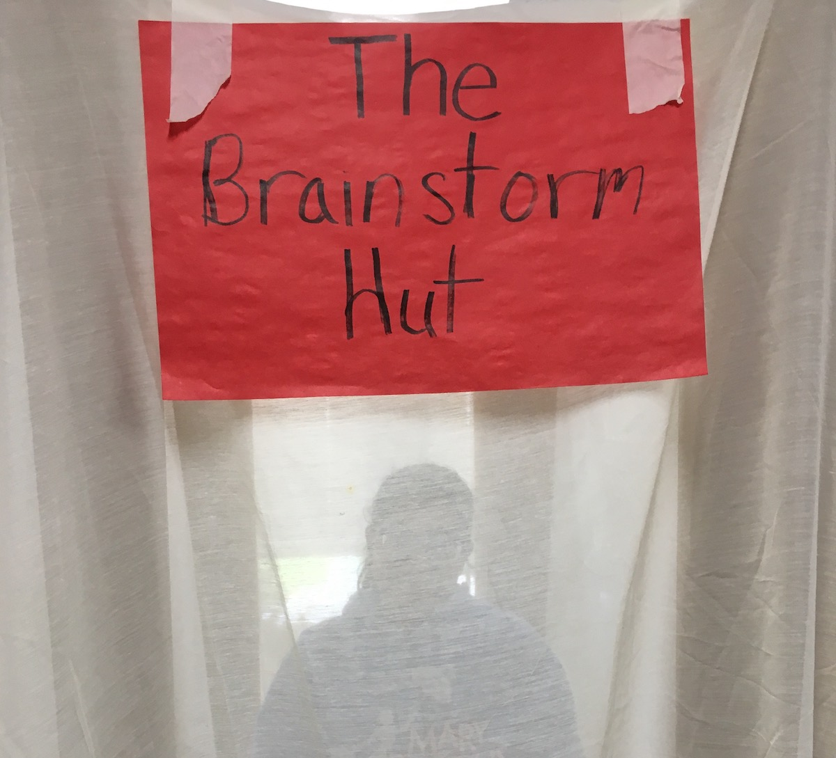 human figure in a brainstorm brainstorm hut