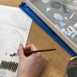 student painting and sketching