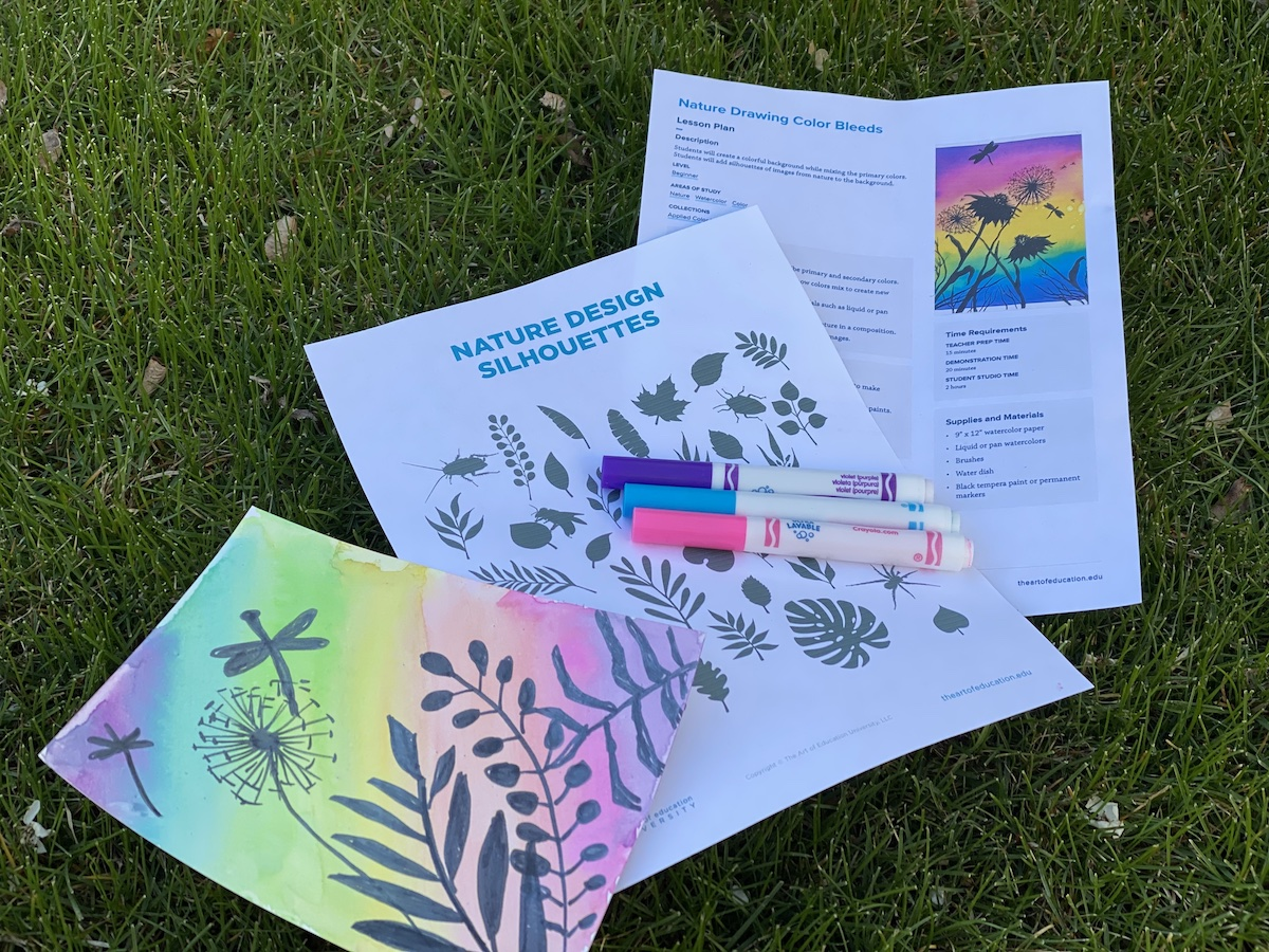 artwork and lesson plan laying in grass