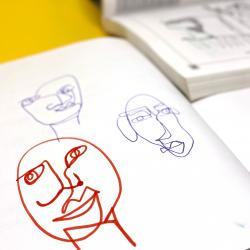 blind contour portrait line drawing in sketchbook
