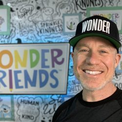 jason tharp photo with wonder friends logo