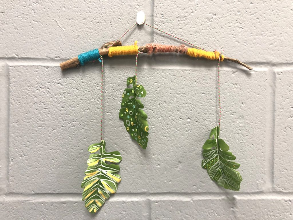 hanging mobile with tree branch and three painted hanging leaves