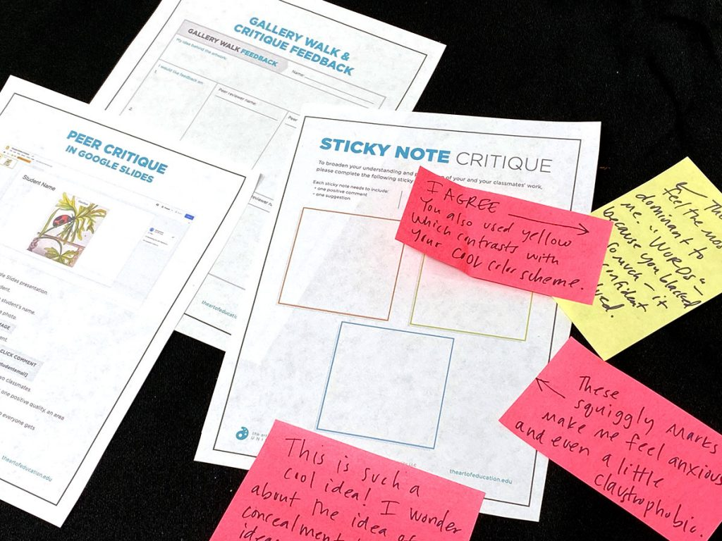 blank critique worksheets with handwritten sticky notes