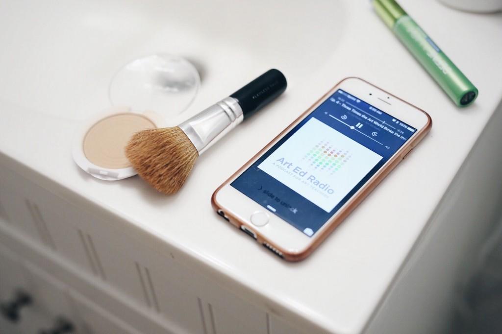 iphone on bathroom counter with art ed radio playing