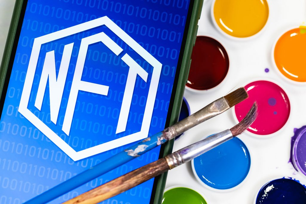 nft logo with watercolor palette and brush