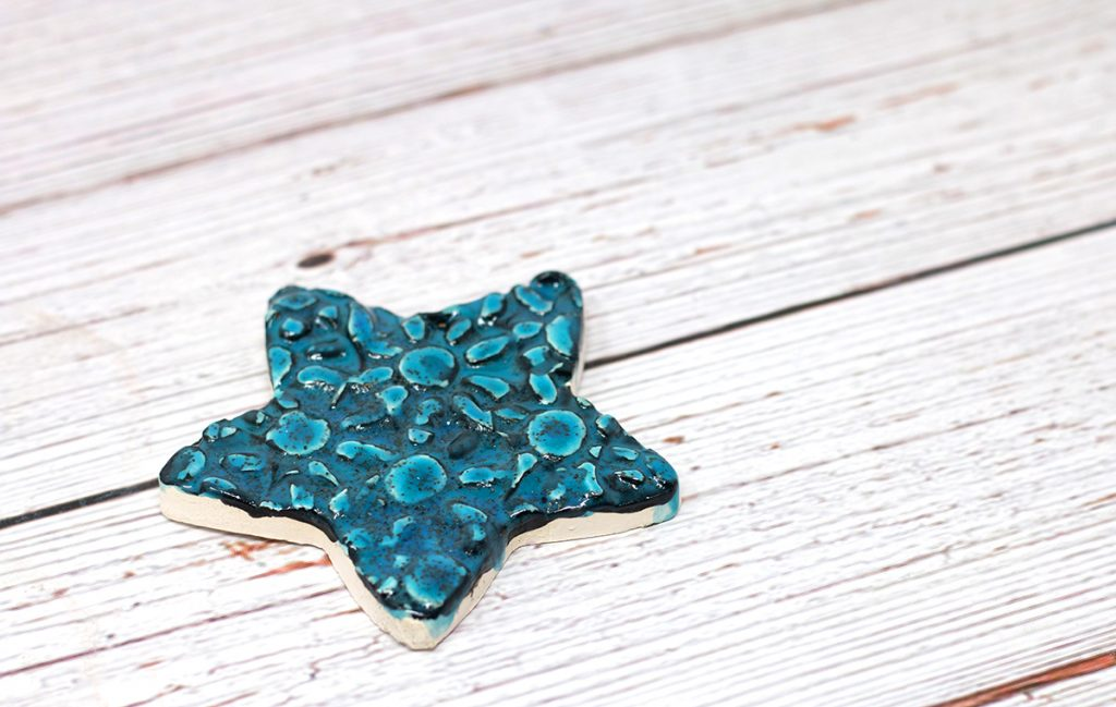 star with blue and green glaze and texture