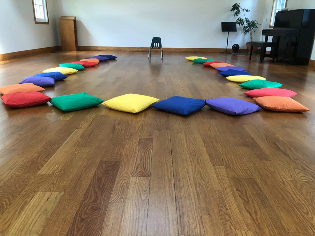 colored cushions on the floor for storytime
