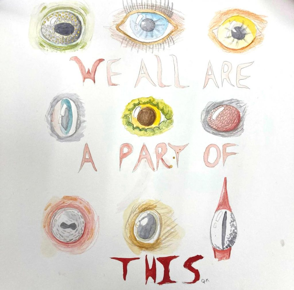 student artwork of eyes with quote we are all a part of this