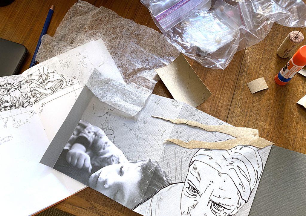 open sketchbook, work in progress, scattered supplies