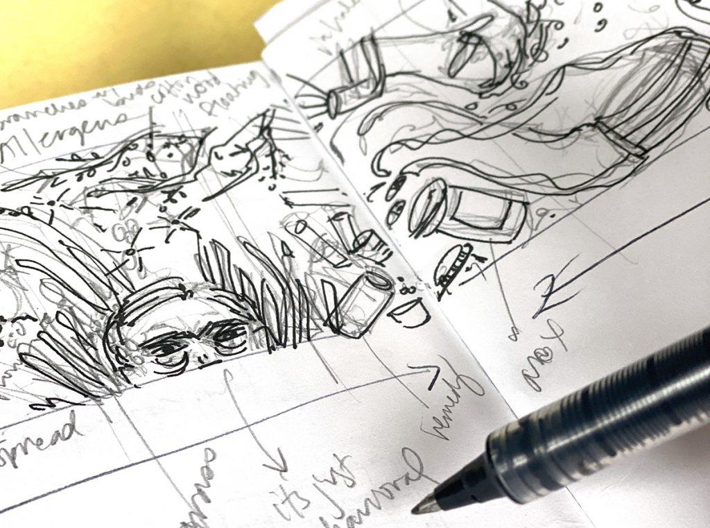 open sketchbook and ink pen