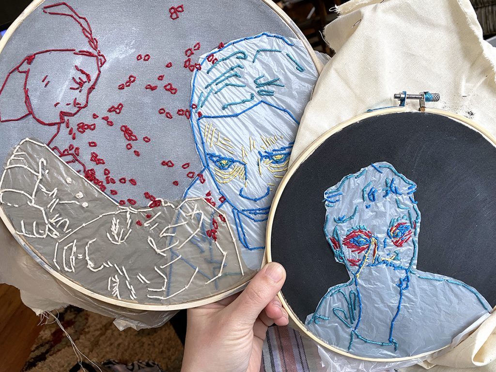 hand holding two embroidery hoops