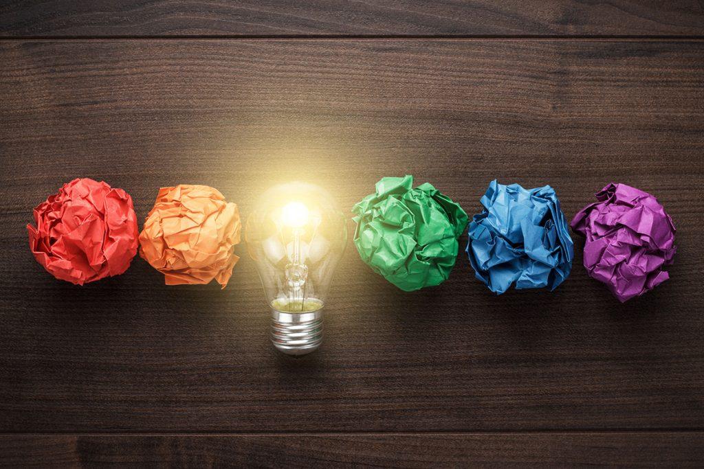 lightbulb with rainbow crumpled paper