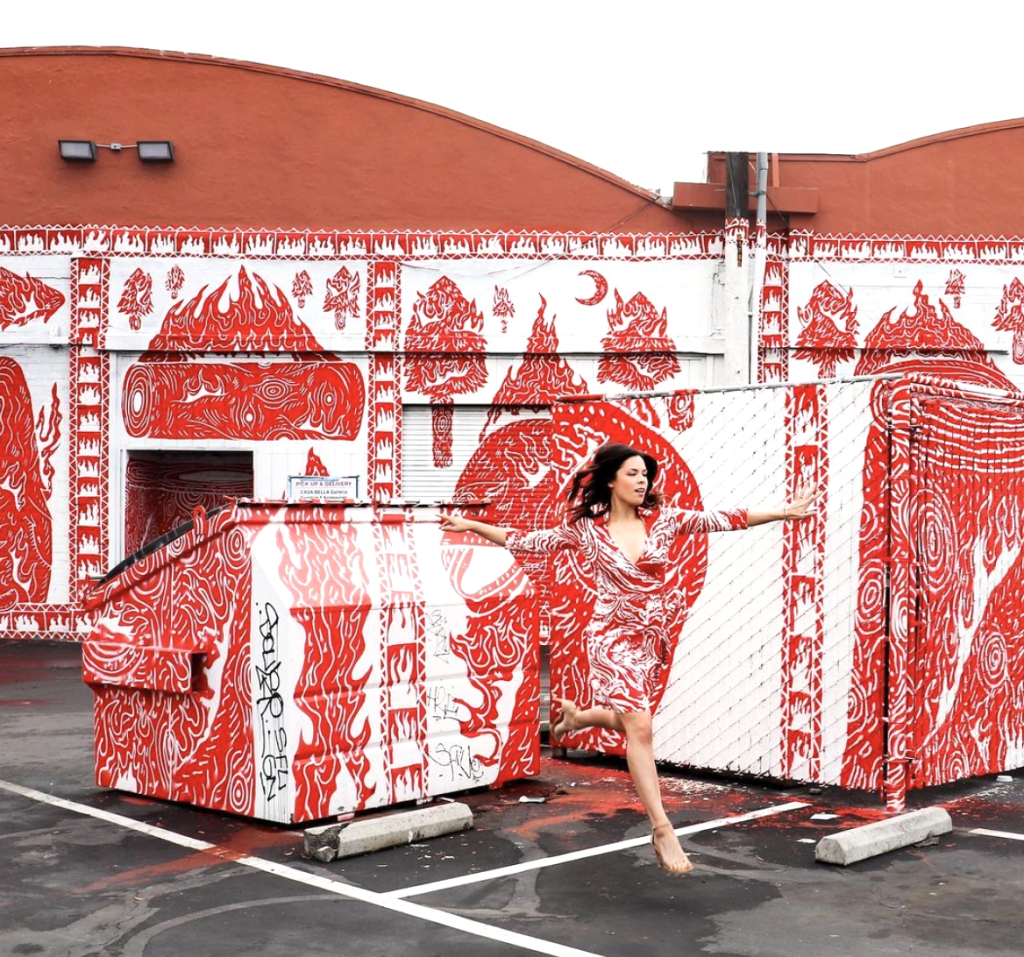 woman with red and white print dress and background
