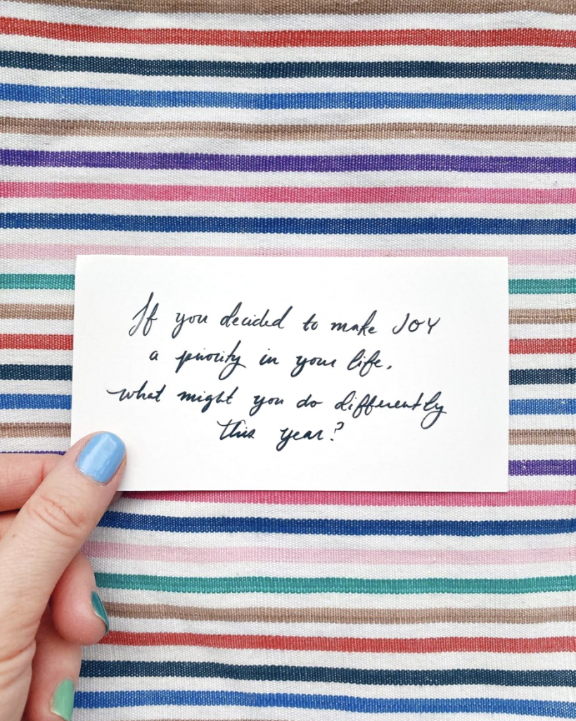 hand holding quote on striped background