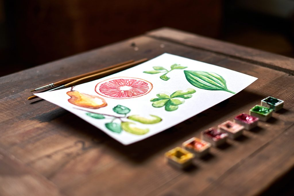 watercolor set with watercolor painting of summer fruit