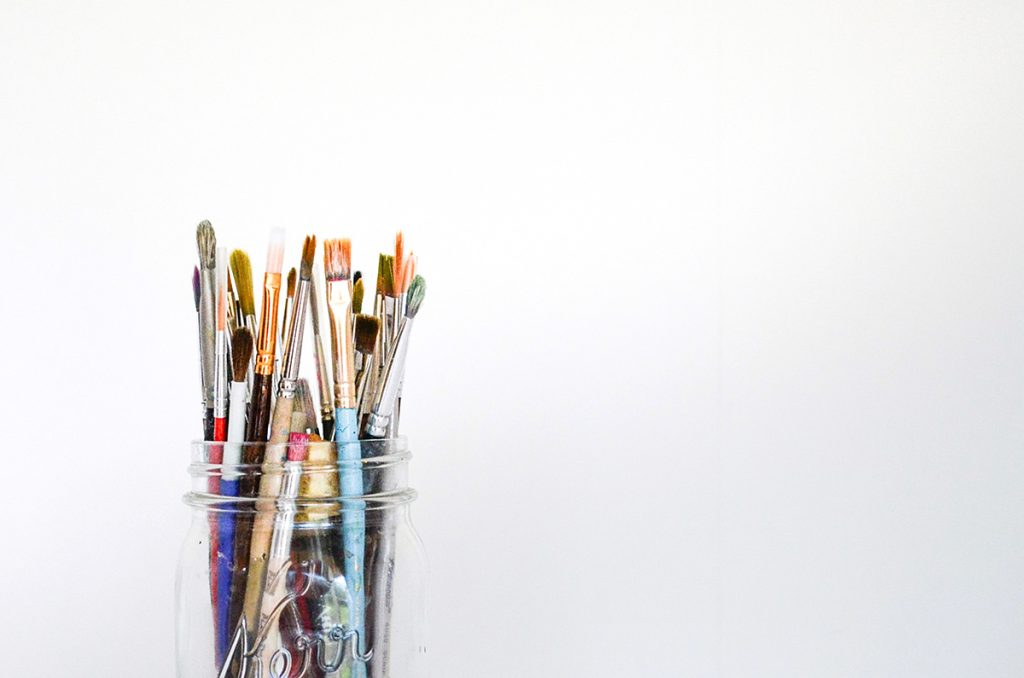 glass jar of paintbrushes