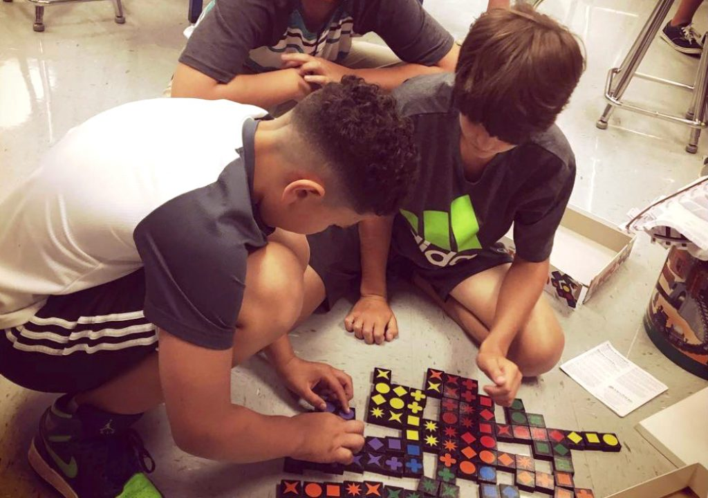 two students playing a game