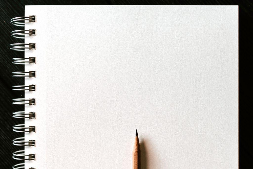 blank sketchbook with pencil