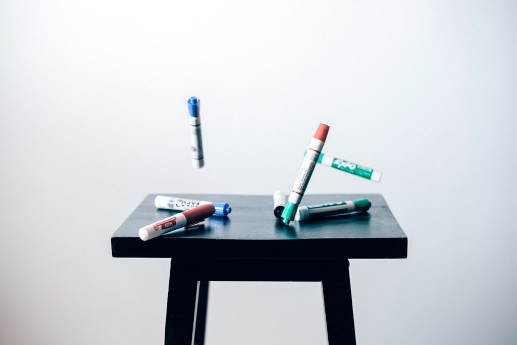 dry erase markers on stool