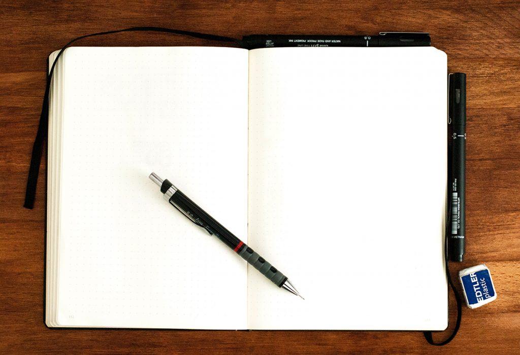 blank sketchbook with pen