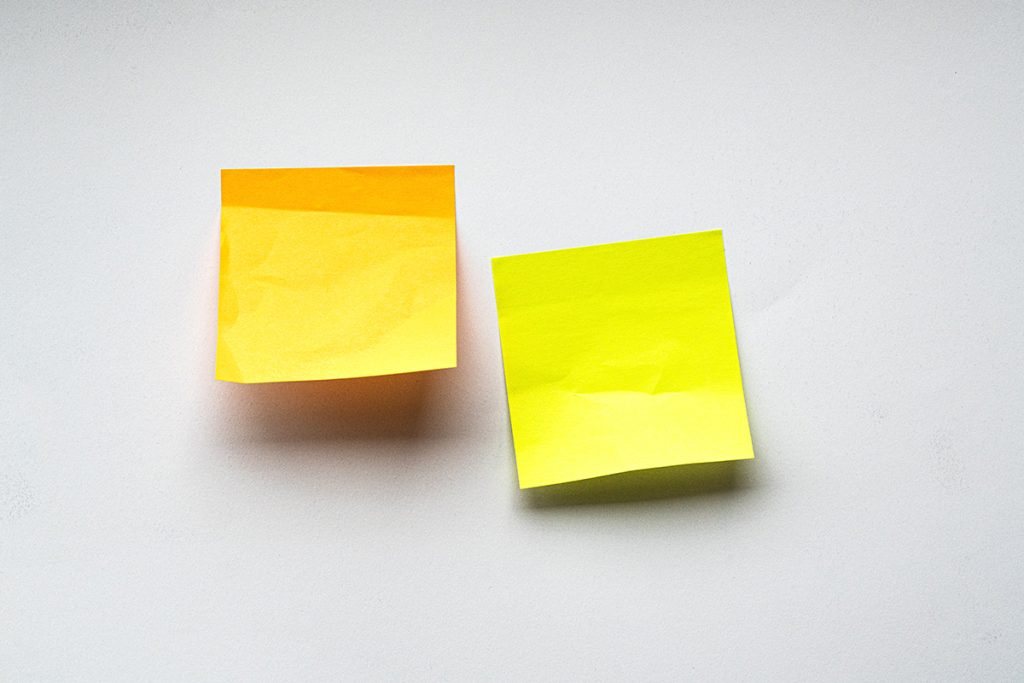 two sticky notes on white background