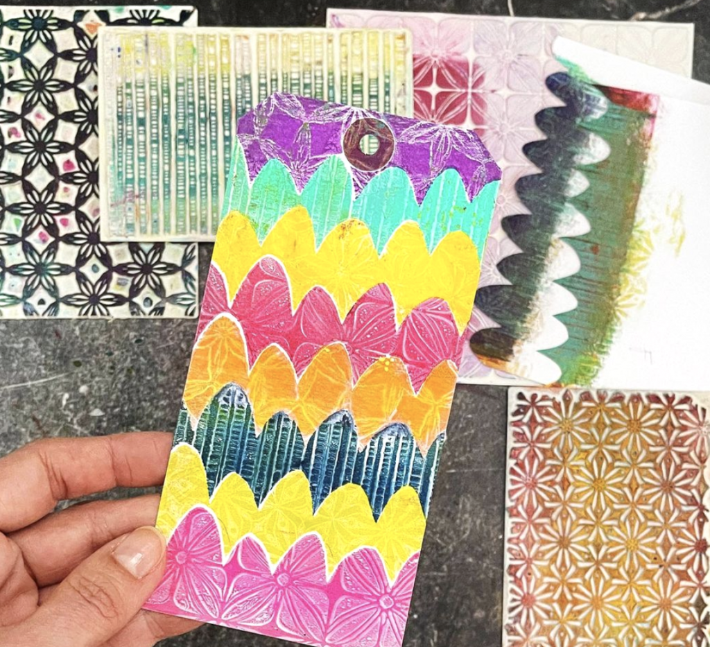 hand holding assorted papers with patterns