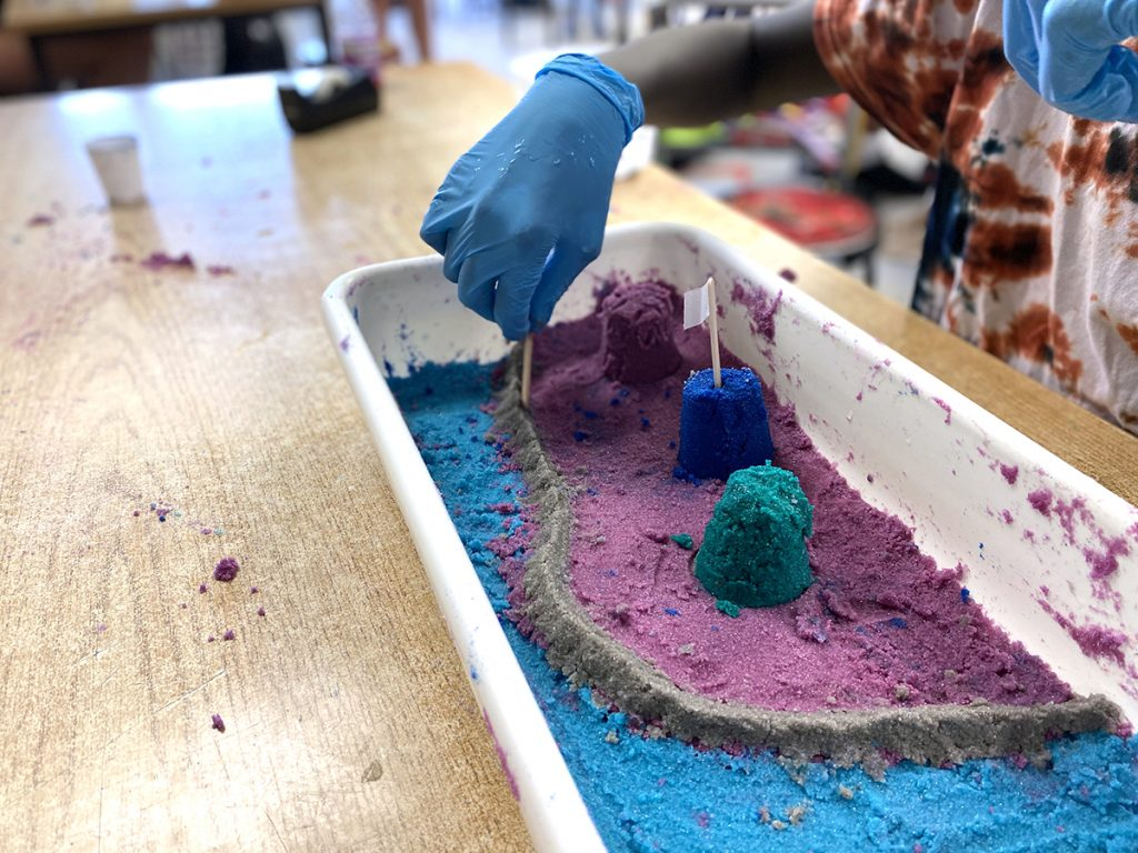student building with colored sand