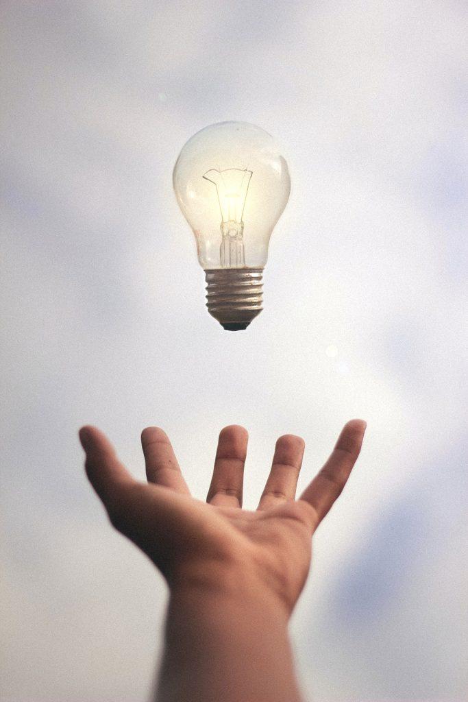 hand reaching for lightbulb
