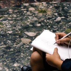 hands with sketchbook
